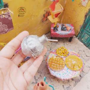 «هبة» تبدع في تجسيد مظاهر الحياة في رمضان علي هيئة مجسمات بالصلصال الحراري