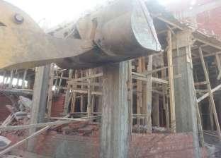 إزالة مبنى مخالف بمنطقة المدبح في السيدة زينب