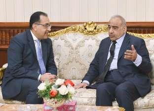 رئيس الوزراء يستقبل نظيره العراقي بمطار القاهرة في أول زيارة له