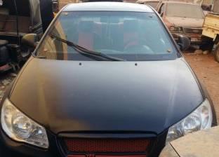 ضبط سيارة مسروقة من حدائق الأهرام أثناء تغيير لونها في الفيوم