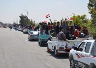 سيارات نقل تجوب شوارع العياط لحث المواطنين على المشاركة في الاستفتاء