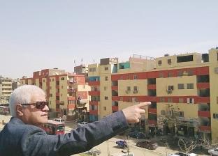 بالصور| رئيس حي البساتين يتفقد طلاء واجهات العقارات على الطريق الدائري