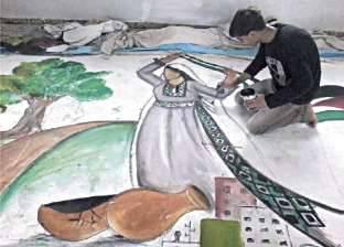 فلسطينى يقاوم الاحتلال الإسرائيلى بالرسم على المدارس وخيام المشردين