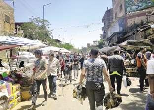 اللهم إني صائم.. سوق الجمعة: زحام على السمك والجمبرى والحمام.. و«ماتخافش من الثعابين والكلاب»