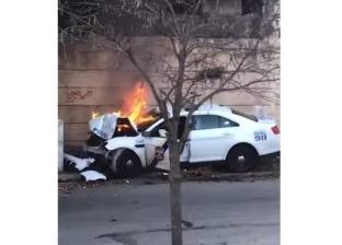 بالفيديو| لحظة إخراج شرطي من سيارة تحترق