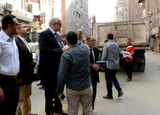 """محافظ الجيزة يشارك في حملة نظافة مع أهالي """"العشرين"""""""
