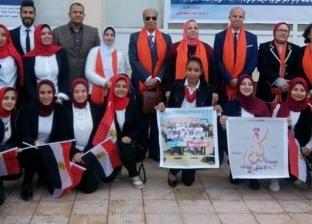 """أساتذة جامعة الإسكندرية يكافحون العنف ضد المرأة بـ""""الكوفية البرتقالي"""""""