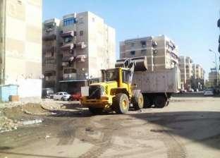 إزالة المخالفات والإشغالات من أعلى عمارات حي المناخ في بورسعيد