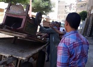 بالصور| إزالة الإشغالات من أمام المدارس في أسيوط