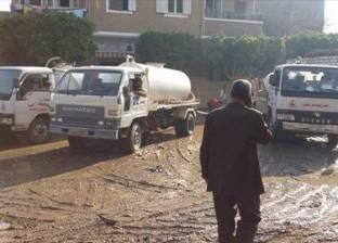 بالصور| شفط المياه من شوارع ومنازل نجع شحات في قنا