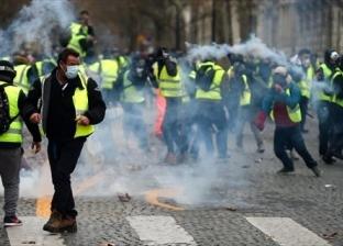 عاجل  اشتعال النار في 12 سيارة بمحيط شارع الشانزليزيه بباريس
