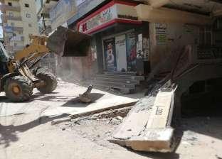حملة لإزالة التعديات علي حرم الطريق العام بالإسكندرية