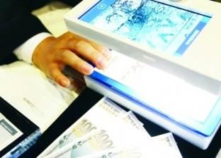هاتف ذكي يكشف العملات والفواتير المزورة