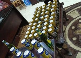 ضبط عاطل بحوزته 720 زجاجة خمور بكفر شكر