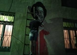 صور| متطوعون يرسمون جرافيتي لصلاح احتفالا بفوزه بجائزة الأفضل بإنجلترا