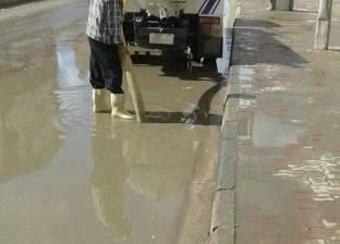 بالصور| تصريف مياه الأمطار من شوارع دمياط