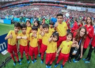 بالصور| أبناء الشهداء برفقة لاعبي السعودية في مباراة روسيا