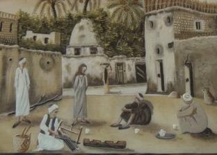أحمد وهبة يرسم لوحات بالرمال