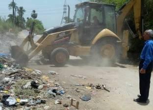 حملة نظافة مكبرة بطريق معبد أبيدوس بسوهاج