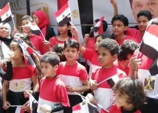 بأعلام مصر وهتافات.. أطفال الزمالك يحثون المواطنين للمشاركة بالاستفتاء
