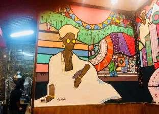 """""""على الأصل دور"""".. جداريات نوبية تزين قهوة عبدالكريم في الإسكندرية"""