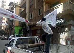 إزالة الإعلانات المخالفة بطريق الحرية في الإسكندرية
