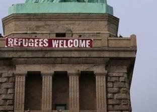 """بالصور  تعليق لافتة """"مرحبا باللاجئين"""" على تمثال الحرية بنيويورك"""