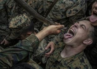 منها شرب دماء الثعابين.. طقوس مقززة داخل المعسكرات الأمريكية