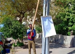 بالصور| حملة لإزالة الإعلانات المخالفة بشوارع النزهة