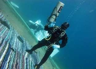 بالصور  الغطاس المصري تحت الماء لليوم الثاني استعدادا لـ«جينيس»