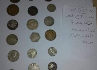 جمارك برج العرب تحبط تهريب 70 عملة معدنية أثرية لعصر الملك فؤاد وفاروق