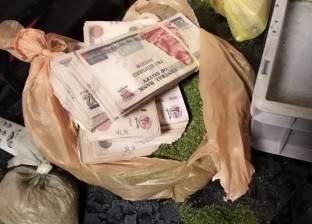 """إحباط محاولة تهريب 100 ألف جنيه داخل """"كيس ملوخية"""" بمطار أسيوط"""
