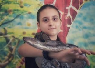 """""""رماج"""" أصغر مربية ثعابين في مصر: """"أحب الشرس ولو عضني"""" (صور)"""