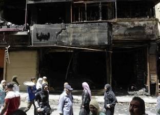عمال المحال المحترقة فى «الموسكى» يبكون بضاعتهم: «مفيش تأمينات ولا تعويضات»