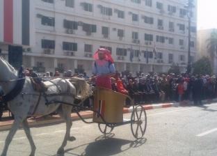 طابور عرض في احتفالات أسوان بالعيد القومي