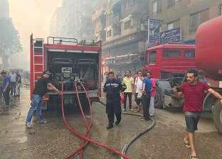 بالصور| إخماد حريق هائل في محل ملابس بالهرم