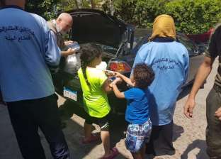 بن راشد توزع وجبات فتة وحلوى على العاملين بمستشفى في مدينة نصر