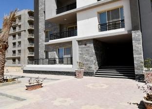 """""""الإسكان"""" تعلن معايير منح الإقامة للأجانب حائزي الوحدات السكنية"""