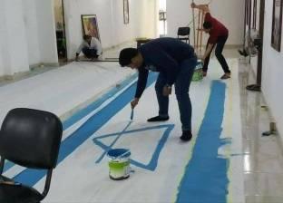 بالصور| تحضيرات أهل غزة لحرق العلم الإسرائيلي بالقرب من الجدار العازل