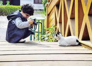 """""""عبدالرحمن"""" 8 سنوات واحترف التصوير.. وأول لقطة لوالده"""