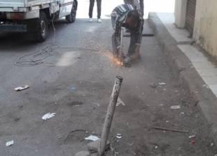 حملة لإزالة الحواجز الحديدية بحي المنتزه أول بالإسكندرية