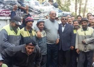 """""""مصر الخير"""" توزع بطاطين الشتاء على عمال النظافة بالجيزة"""