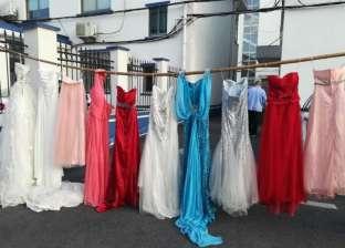 خمسيني صيني يسرق فساتين زفاف.. والسبب غريب