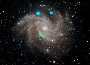 أضواء ملونة صادرة من مجرة بعيدة تثير حيرة ناسا