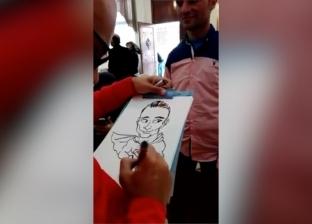 في يوم تكريمه.. رسمة كاريكاتيرية لبطل إنقاذ محطة مصر هدية من إسلام
