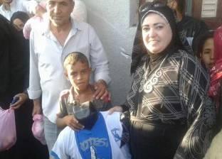 """بالصور  جمعية """"أبناء سيناء"""" تنظم معرضا لكساء ألف طفل بقرية فيران"""
