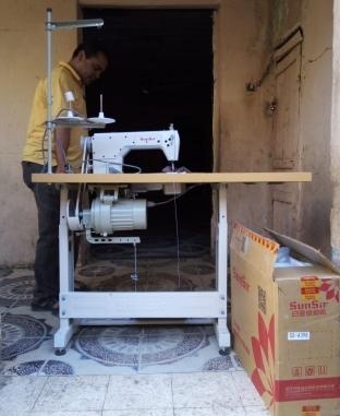 تسليم ماكينات خياطة للمعيلات في الفيوم