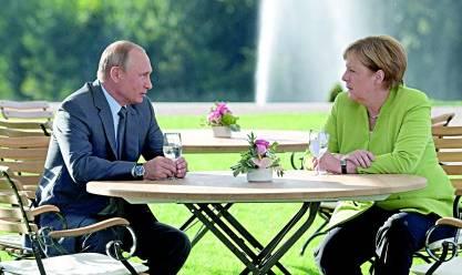 «بوتين» و«ميركل» يتفقان على إعادة اللاجئين إلى سوريا: «أولوية قصوى»
