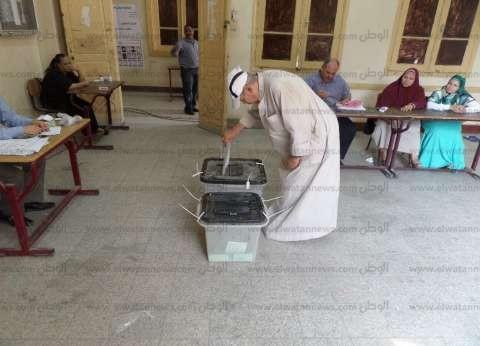 """انخفاض أعداد الناخبين في لجان قرية """"ضحايا حريق عمان"""" بأسيوط"""