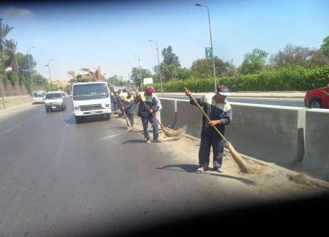 """""""نظافة الجيزة"""" ترفع كفاءة طريق """"مصر - إسكندرية"""" الصحراوي"""